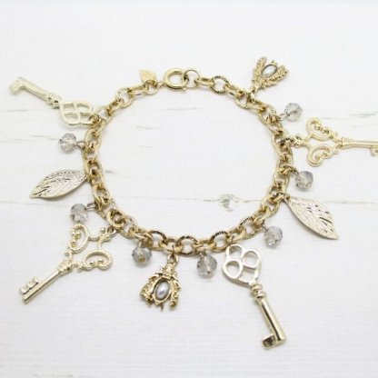 1960s Sarah Coventry Vintage 'Key To The Door' Gold Cham Bracelet